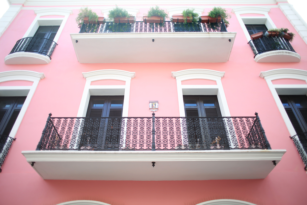 balconies on a pink colorful building in puerto rico