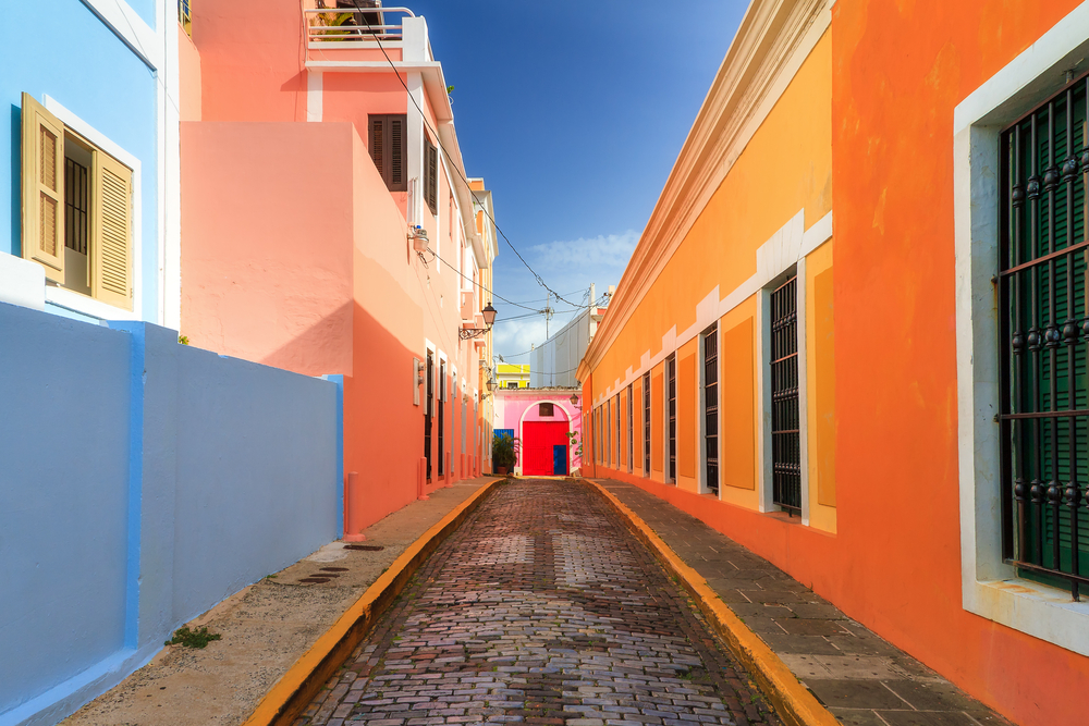a view down a colorful alleyway in puerto rico