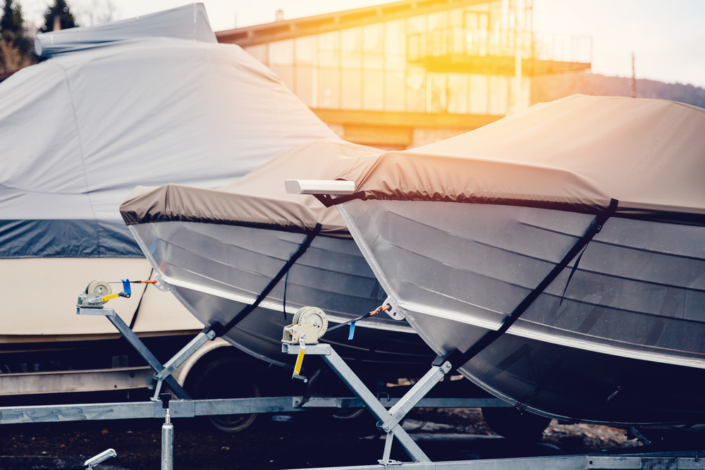 Row of boats in storage for the winter under the awning. Warehouse on the boat pier. Concept preparation for winter..jpg